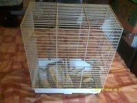 A BIRDCAGE IN EXCELLENT CONDITION with SWING, LADDER , and TOYS plus SAND SHEETS +