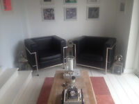PAIR OF LE CORBUSIER ARM CHAIRS