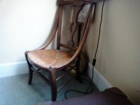 Vintage dark wood chair with rush seat