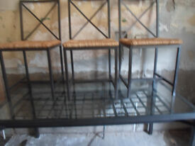 lovely glass top table and 4 chairs