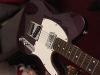 Electric guitar fender telecaster squier purple