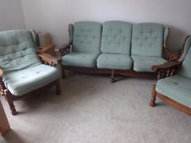 Three seater sofa and two armchairs, good condition, wooden frame, green fabric