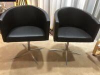 Two black swivel chair's