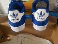 Blue and white Adidas trainers size 7
