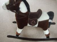 TOY ROCKING HORSE IN BROWN & WHITE FUR WITH BROWN SUEDE SADDLE