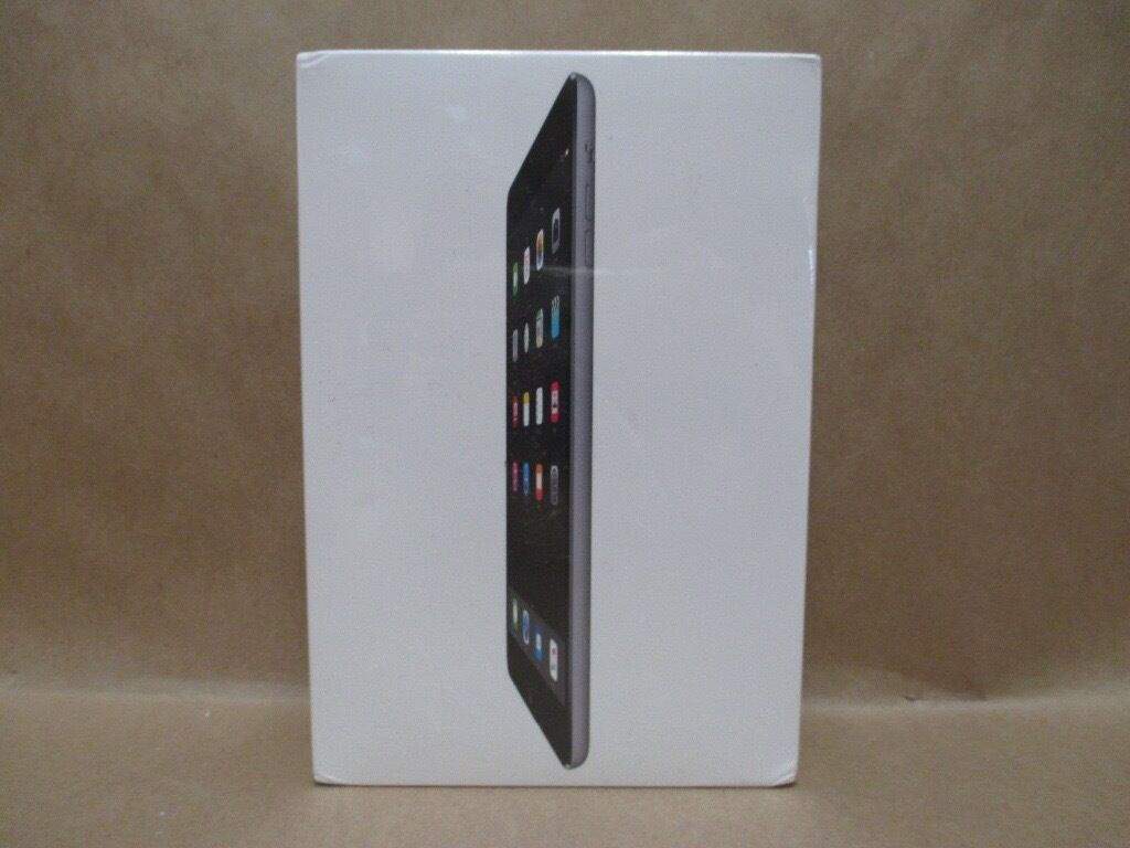 **SEALED** 32GB IPAD MINI2 BRAND NEW, WIFI AND INCLUDES 1 YEAR APPLE WARRANTY