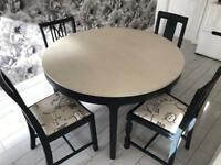 Kitchen/dining table with four different chairs