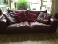 Two four seater red/burgundy leather sofas plus armchair