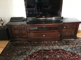 Superb large TV cabinet with cupboards and drawers in dark mahogany colour.