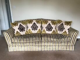 Large Brown , gold and cream Sofa with 4 riversable large cushions , very comfortable.