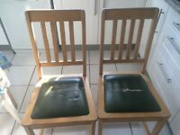2 solid wood kitchen chairs (IKEA). Free for collection only