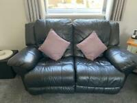 Black leather reclining 3 seater and 2 seater sofa