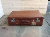 Brown Globetrotter suitcase