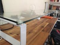 Large glass desk monitor riser.