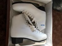 2 sets of ice skates