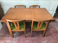 Vintage teak extending dining table and 4 chairs