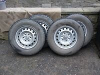 Set of 4 steel wheels + tyres for Mitsubishi L200 pickup.