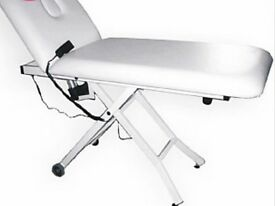 Electric beauty/massage bed. New costs £799 plus VAT. Perfect condition. Strong and comfortable.