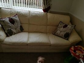 Cream leather 3 seater settee with matching armchair and footstool