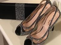Sparkly black heels and matching clutch