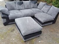 Superb black and grey corner sofa and footstool. or larger corner.1 month old. clean. can deliver
