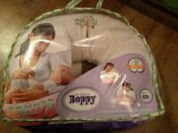 Boppy cushion with velour cover for baby feeding