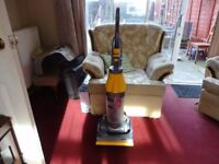yellow and grey dyson in working order