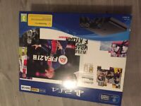 PS4 500gb 2 controllers, unused in box. Headset and usb
