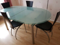 Calligaris glass and steel dining table and chairs