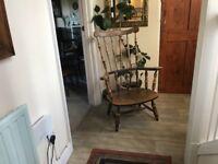 Antique beech wood nursing chair.