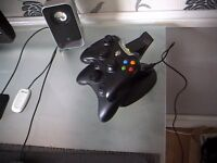 xbox360 charging dock + 2 controllers one flots to the left now and then so £25