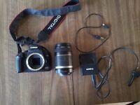 Canon EOS 1000D camera + efs 55-250mm lens