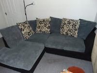 Grey suede corner sofa. In very good condition.