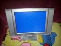 """Swisstec 15"""" lcd tv with wall bracket and remote in working order"""