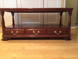 Solid wood coffee table ,mahogany,with three drawers.