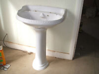 white basin and pedestal in good condition