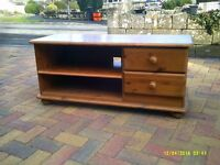 A pine coloured TV cabinet