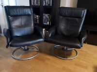 Two IKEA Mulung black leather reclining and swivel armchais