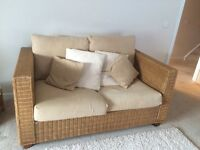 2 two seater wicker sofas and 6 matching wicker kitchen chairs. Excellent condition.