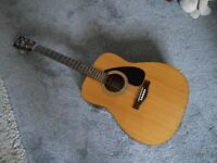 Yamaha 6 string acoustic guitar model F310 Jumbo style
