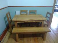 Solid oak extendible dining table and chairs