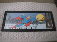 SUPERMAN ICONIC IMAGE FRAMED PRINT. BLACK WOODEN FRAME 34.5 INCHES X 14.5 INCHES.