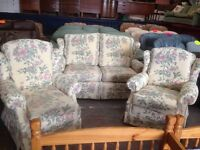 Cream patterned sofa and chairs