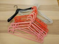 28 assorted clothes hangers