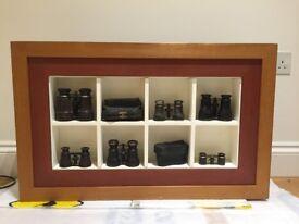 Decorative frame with vintage binoculars