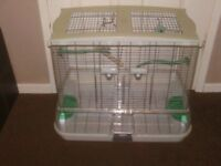BIRD CAGE VISION WITH POTS AND PERCHES £30