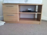 TV cabinet and wooden chest of drawers available for sale.