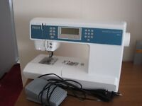 Pfaff Ambition Essential Sewing Machine with IDT and 110 stitches.