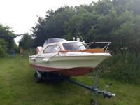 Shetland day weekend boat. 60hp outboard. Trailer