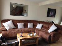 Suede corner sofa.